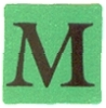 Green sticker with 'M'